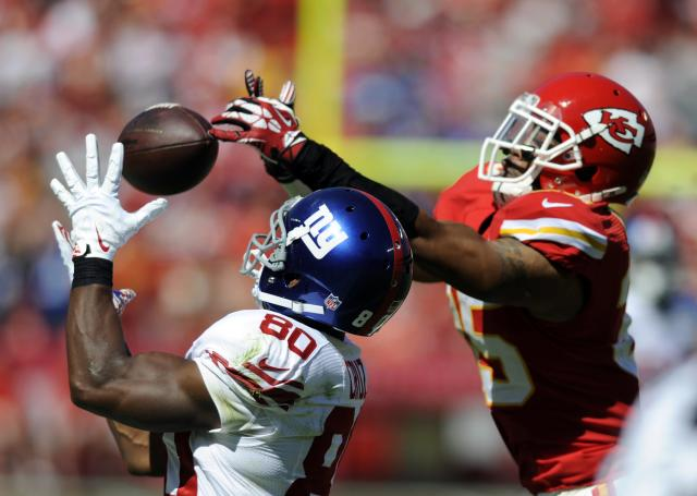 Kansas City Chiefs defensive back Quintin Demps breaks up a pass intended for New York Giants wide receiver Victor Cruz during the first half of their NFL football game in Kansas City, Missouri September 29, 2013. REUTERS/Dave Kaup (UNITED STATES - Tags: SPORT FOOTBALL)