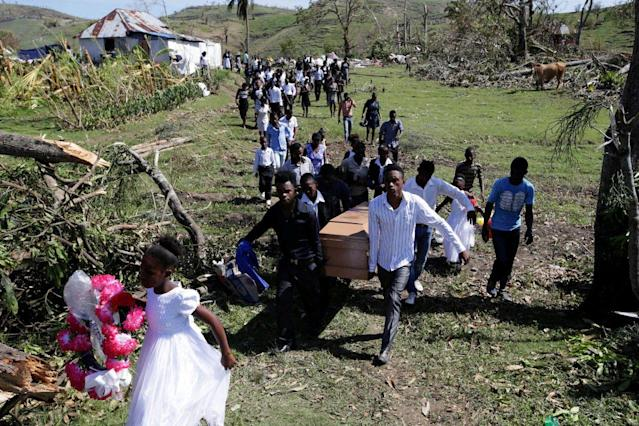 <p>Friends and relatives attend the funeral of Anne Dit Trozitha Zamore, who died during Hurricane Matthew, in Chantal, Haiti, Oct. 8, 2016. (Photo: Andres Martinez Casares/Reuters) </p>