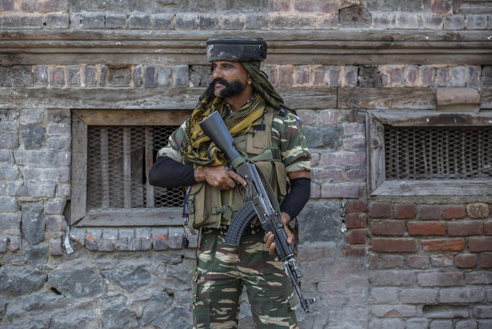 An Indian paramilitary soldier guards a deserted street in Srinagar, Indian controlled Kashmir, Sunday, Sept. 5, 2021. Authorities Sunday eased some restrictions that had been imposed after the death of top resistance leader Syed Ali Geelani. However, most shops and businesses stayed closed as government forces patrolled roads and streets in the city. (AP Photo/Mukhtar Khan)
