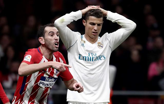 "<a class=""link rapid-noclick-resp"" href=""/soccer/players/cristiano-ronaldo/"" data-ylk=""slk:Cristiano Ronaldo"">Cristiano Ronaldo</a> and <a class=""link rapid-noclick-resp"" href=""/soccer/teams/real-madrid/"" data-ylk=""slk:Real Madrid"">Real Madrid</a> were frustrated in the Madrid Derby – and have been frustrated throughout the first three months of the season. (Getty)"