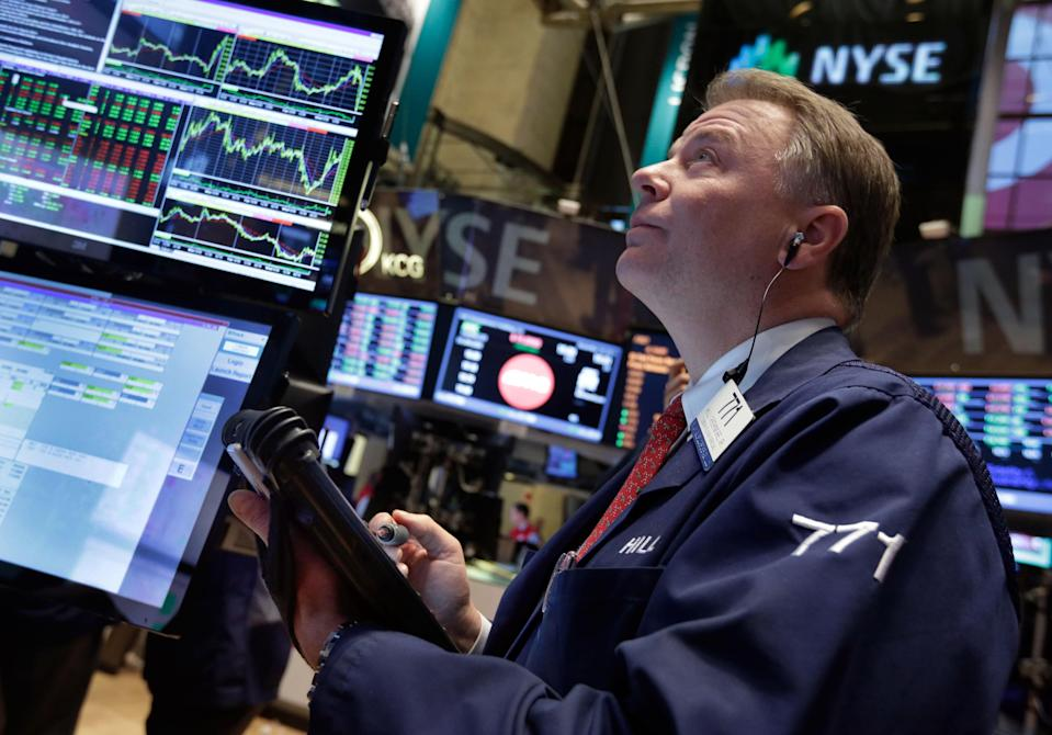 Trader F. Hill Creekmore works on the floor of the New York Stock Exchange Wednesday, Dec. 18, 2013. Stocks surged after the Federal Reserve decided the U.S. economy was strong enough for it to reduce its stimulus efforts. (AP Photo/Richard Drew)