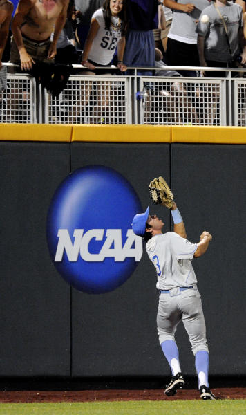 UCLA outfielder Christoph Bono catches a fly ball hit by North Carolina State's Trea Turner to end the eighth inning of an NCAA College World Series baseball game in Omaha, Neb., Tuesday, June 18, 2013. (AP Photo/Eric Francis)