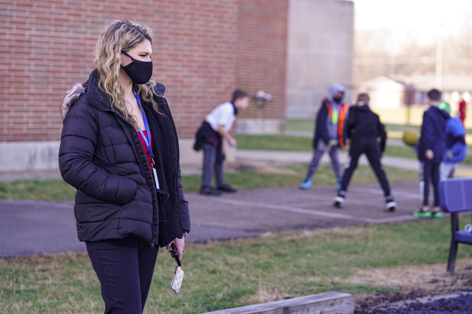 Grace Kern, a substitute teacher at the Greenfield Intermediate School in Greenfield, Ind., is photographed Thursday, Dec. 10, 2020. Kern, a student at IUPUI in Indianapolis, is one of several college students being recruited to work as substitute teachers in schools during the pandemic. (AP Photo/Michael Conroy)