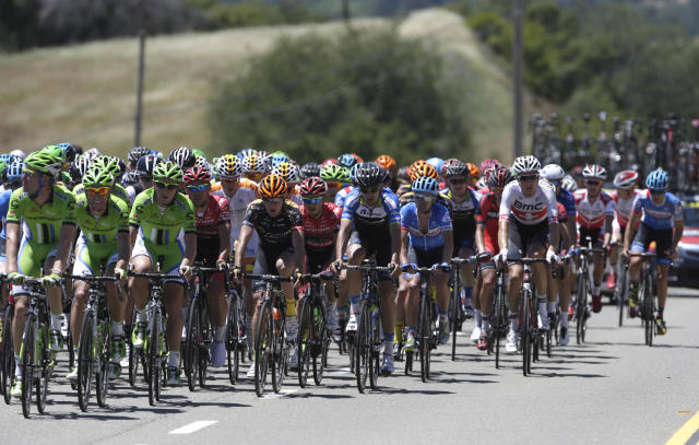 The peloton climbs Indian Hill Road after leaving Newcastle Calif., during Stage I of the Tour of California cycling race Sunday, May 11, 2014.(AP Photo/Rich Pedroncelli)