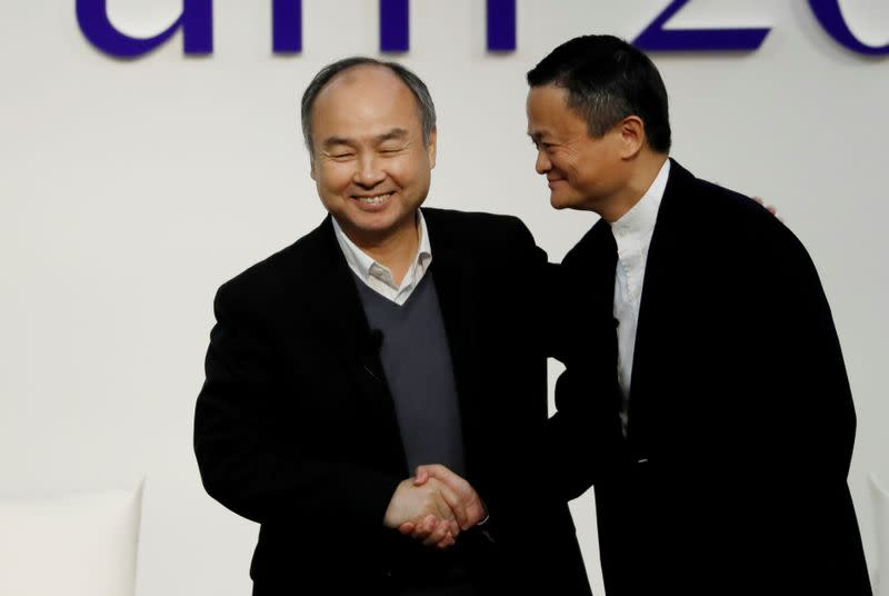 SoftBank Group founder and CEO Masayoshi Son and Alibaba founder and former Chairman Jack Ma shake hands at the Tokyo Forum 2019 in Tokyo