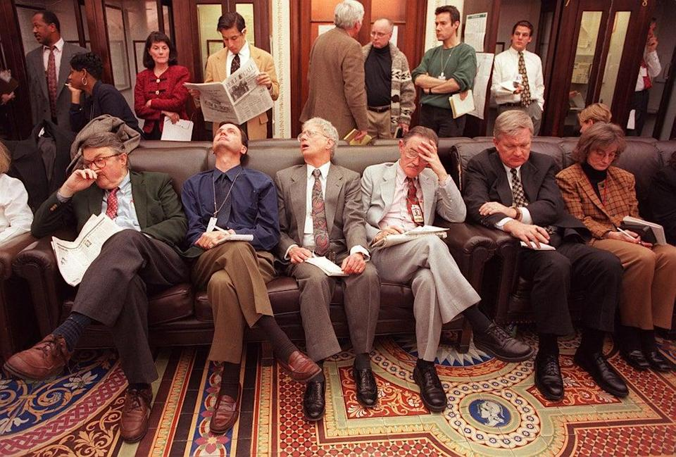 Members of the press wait outside the Senate chamber as the impeachment trial of US President Bill Clinton begins on 7 January 1999 on Capitol Hill (MARIO TAMA/AFP via Getty Images)