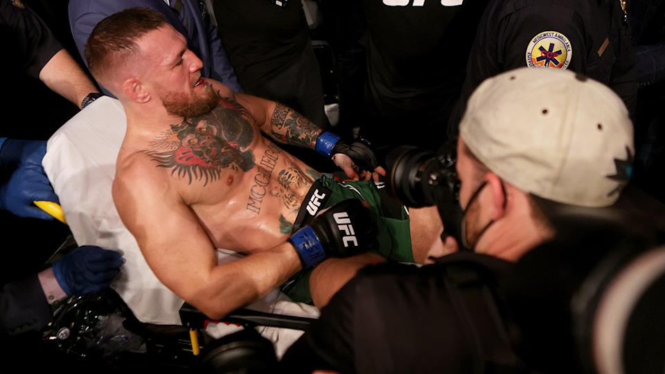 Conor McGregor was taken from the UFC 264 ring on a stretcher after breaking his ankle against Dustin Poirier. (Photo by Stacy Revere/Getty Images)