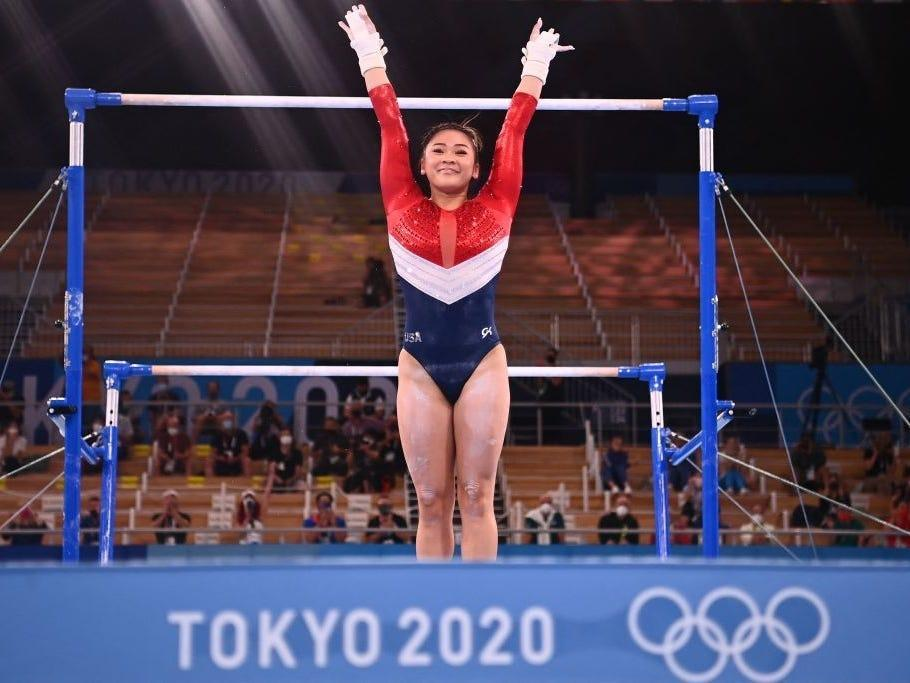 Suni Lee competes on uneven bars