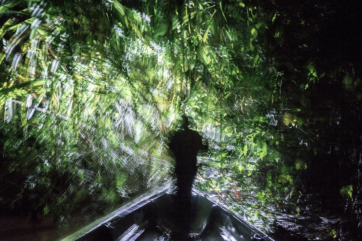 <p>Jose Miguel Santi leads a night hunting expedition on his cousin's boat in the Ecuadorean Amazon. (© Misha Vallejo) </p>