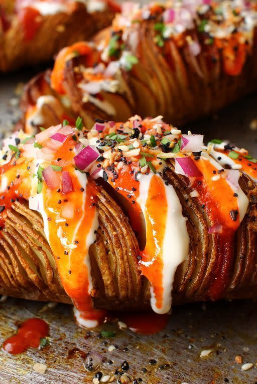 """<p>Hasselbackspotatis, aka Hasselback potatoes, are a Swedish invention that transforms a humble baked potato into an ingenious work of art. Each potato is partially sliced into a row of thin slivers that then get brushed with oil or butter and baked to roasty-toasty crispy-crunchy perfection.</p><p>Get the <a href=""""https://www.delish.com/uk/cooking/recipes/a35223055/hasselback-potatoes-recipe/"""" rel=""""nofollow noopener"""" target=""""_blank"""" data-ylk=""""slk:Hasselback Potatoes"""" class=""""link rapid-noclick-resp"""">Hasselback Potatoes</a> recipe.</p>"""