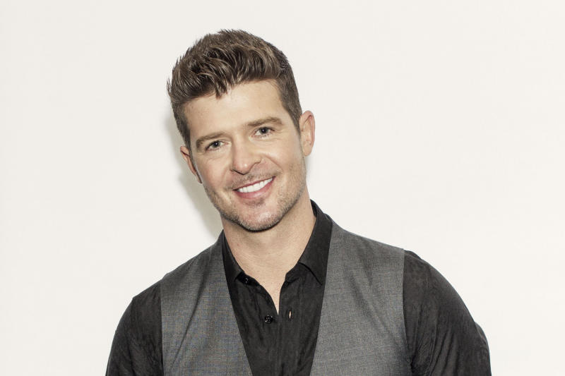 "This Aug. 1, 2013 photo shows R&B singer-songwriter Robin Thicke in New York. Thicke released his fifth album, ""Blurred Lines,"" on Aug. 2. The title track and lead single, which features T.I. and Pharrell, is the longest-running No. 1 song on the Billboard Hot 100 chart so far this year. (Photo by Victoria Will/Invision/AP)"