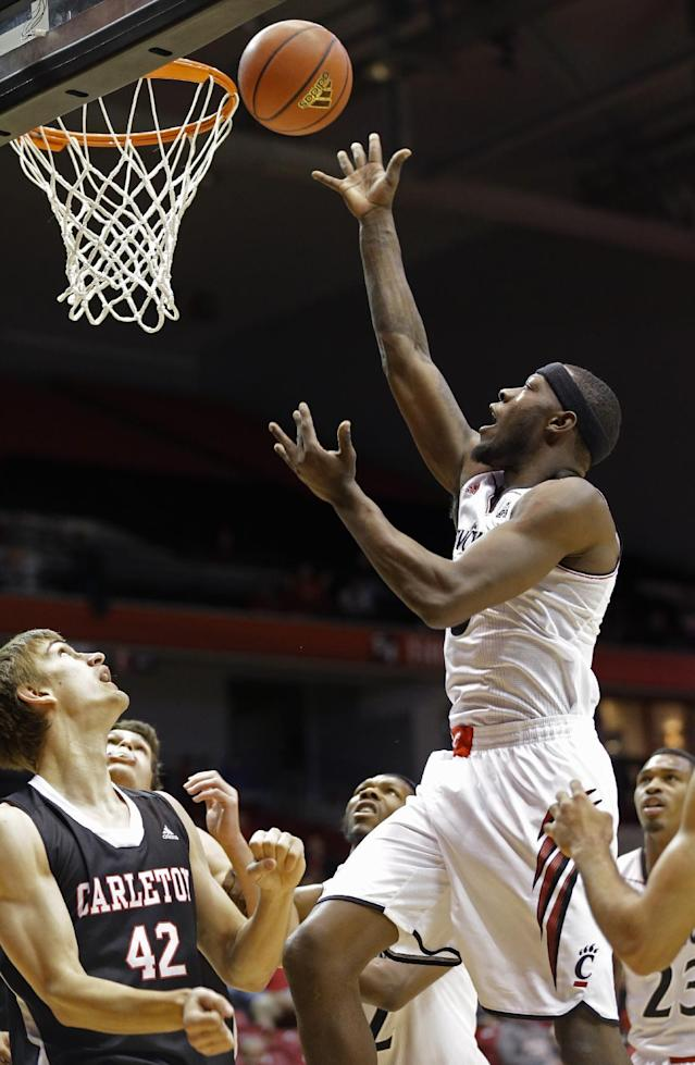 Cincinnati forward Justin Jackson, right, shoots over Carleton forward Tyson Hinz (42) in the first half of an NCAA exhibition college basketball game, Saturday, Oct. 26, 2013, in Cincinnati. (AP Photo/Al Behrman)