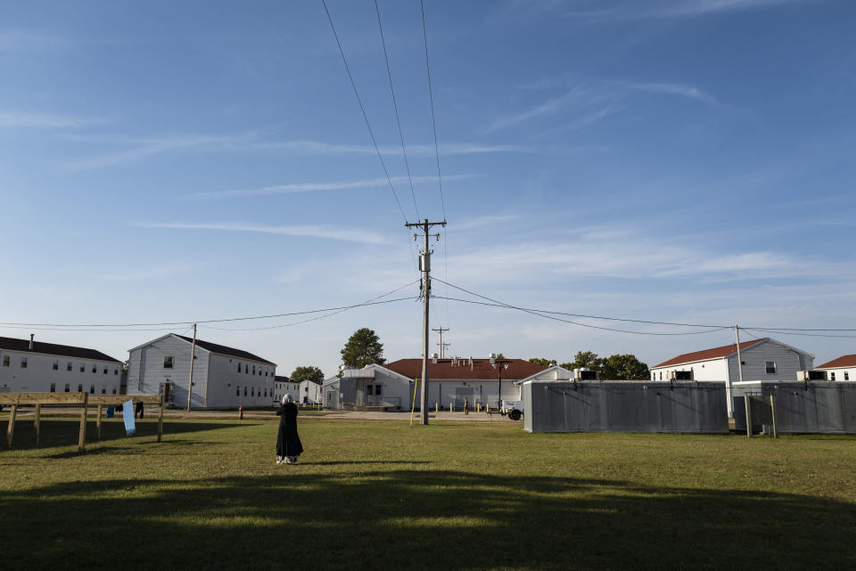 An Afghan refugee walks in the Village, where they are temporarily living at Ft. McCoy U.S. Army base on Thursday, Sept. 30, 2021 in Ft. McCoy, Wis. The fort is one of eight military installations across the country that are temporarily housing the tens of thousands of Afghans who were forced to flee their homeland in August after the U.S. withdrew its forces from Afghanistan and the Taliban took control. (Barbara Davidson/Pool Photo via AP)
