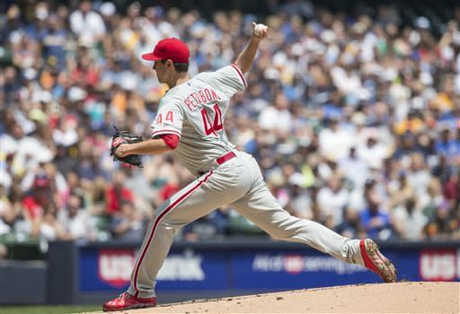 Philadelphia Phillies' Jonathan Pettibone pitches to a Milwaukee Brewers batter Michael during the first inning of a baseball game on Sunday, June 9, 2013, in Milwaukee. (AP Photo/Tom Lynn)