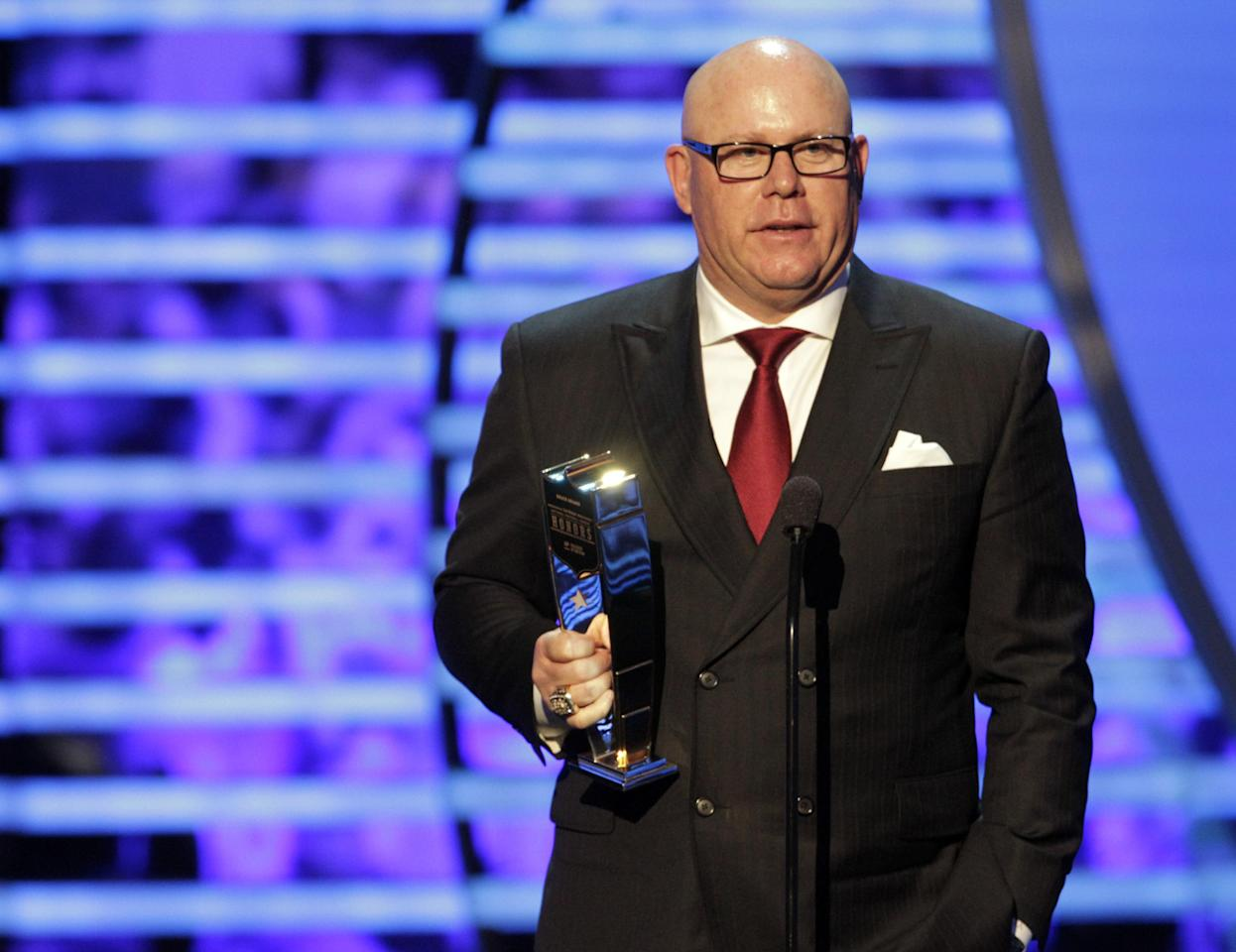 Bruce Arians, formerly with the Indianapolis Colts and now with the Arizona Cardinals, accepts the AP Coach of the Year award at the 2nd Annual NFL Honors on Saturday, Feb. 2, 2013 in New Orleans. (Photo by AJ Mast/Invision/AP)