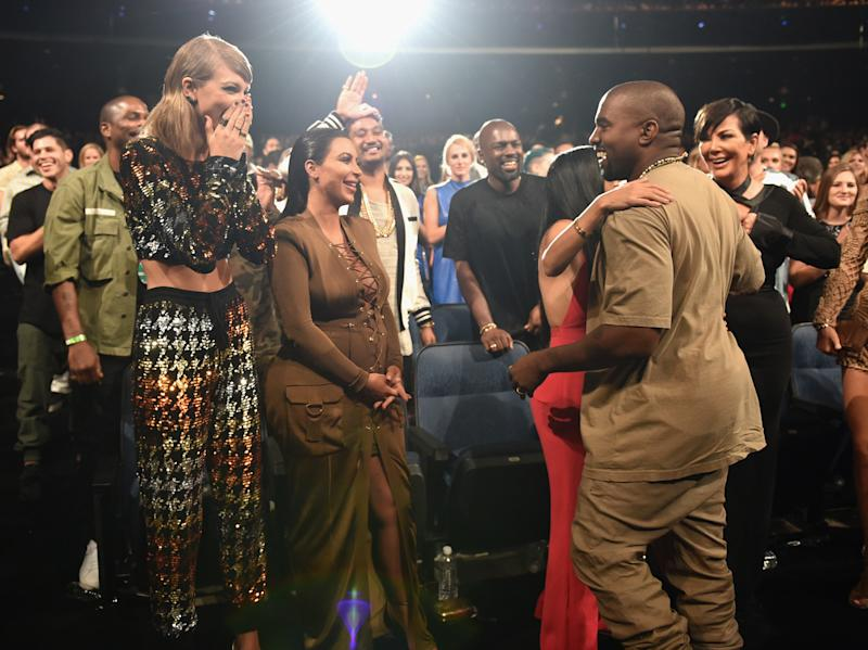 Taylor Swift, Kim Kardashian, Kourtney Kardashian, Kanye West and Kris Jenner in the audience during the 2015 MTV Video Music Awards. (Photo: John Shearer/Getty Images)