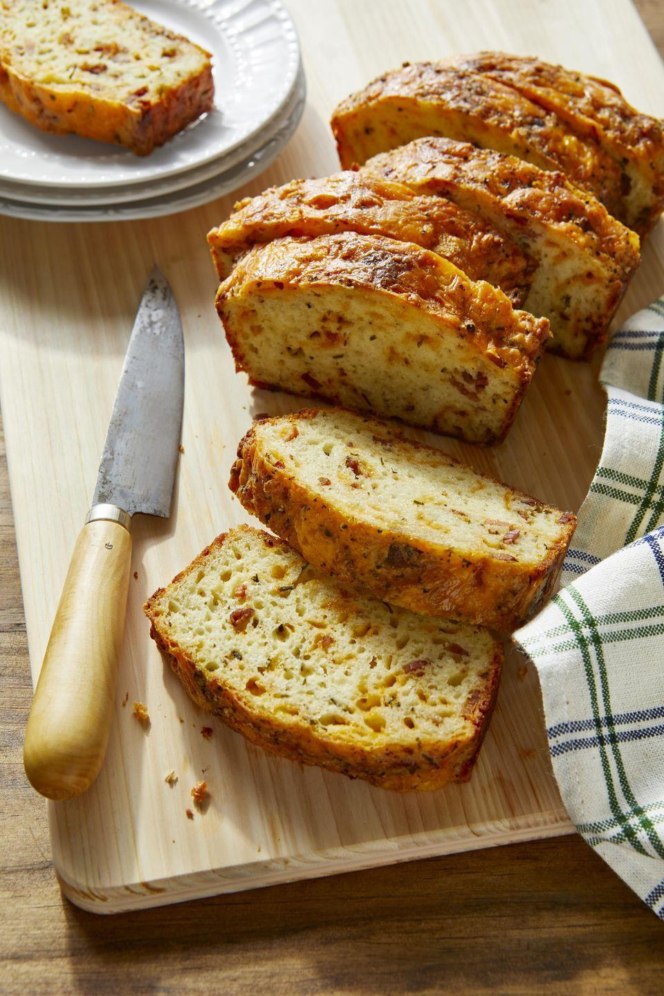 """<p>More in the mood for a savory breakfast-type treat? Bake this, and the smell will have the whole family gathered in the kitchen.</p><p><strong><a href=""""https://www.countryliving.com/food-drinks/a32213633/cheddar-bacon-and-chive-quick-bread/"""" rel=""""nofollow noopener"""" target=""""_blank"""" data-ylk=""""slk:Get the recipe"""" class=""""link rapid-noclick-resp"""">Get the recipe</a>.</strong></p><p><a class=""""link rapid-noclick-resp"""" href=""""https://www.amazon.com/USA-Pan-1140LF-Bakeware-Aluminized/dp/B0029JQEIC/?tag=syn-yahoo-20&ascsubtag=%5Bartid%7C10050.g.35246097%5Bsrc%7Cyahoo-us"""" rel=""""nofollow noopener"""" target=""""_blank"""" data-ylk=""""slk:SHOP LOAF PANS"""">SHOP LOAF PANS</a><br></p>"""