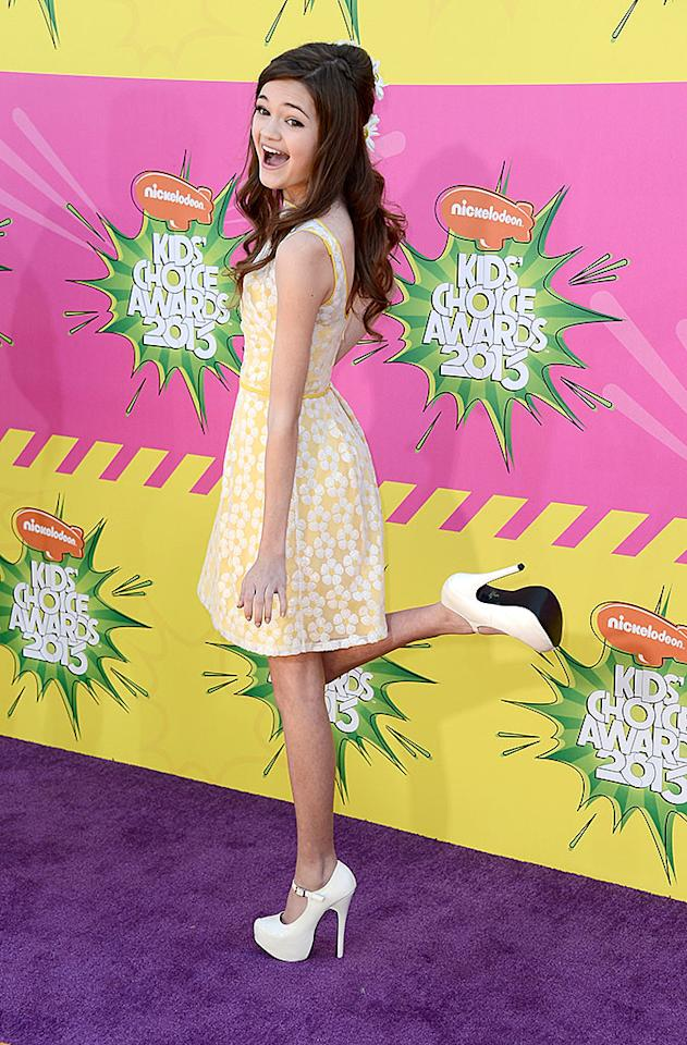"""Big Time Rush"" star Ciara Bravo kicked up her (very high) heels in a fun yellow-and-white frock."