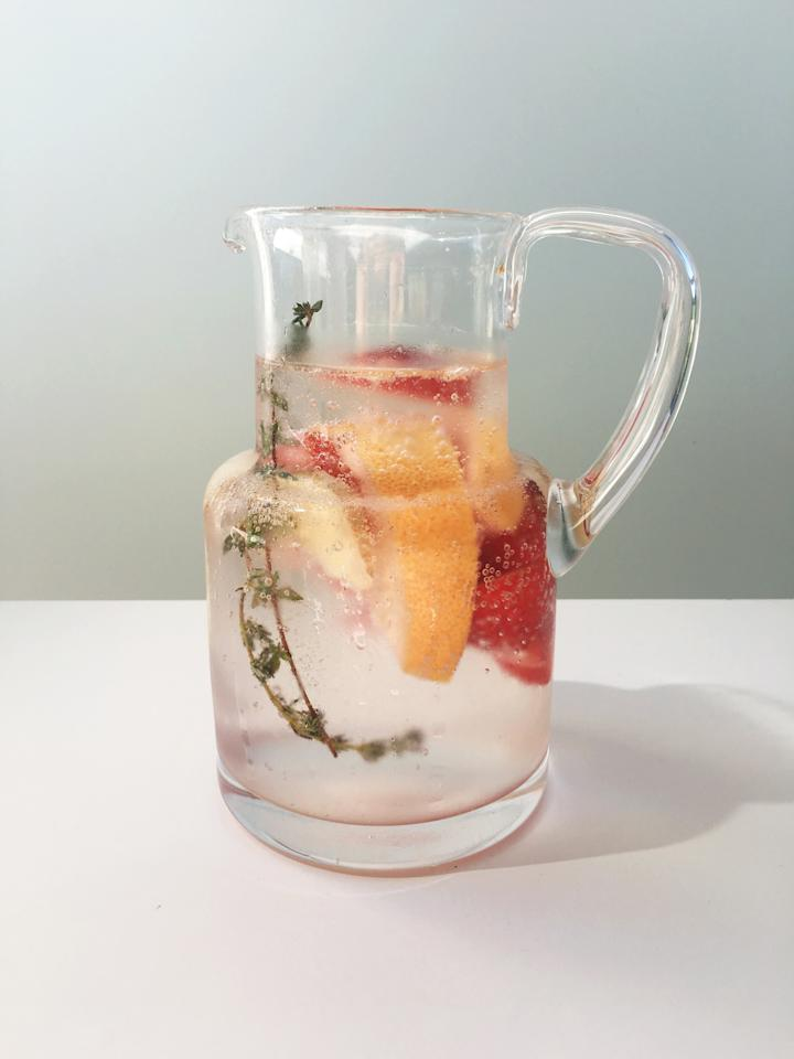 <p>Skip the spoon and enjoy your morning grapefruit in your water. The sliced ginger brings a kick to your everyday water while the strawberries add a touch of sweetness. Pair with sparkling water for an afternoon pick-me up without any added sugar or calories.<br /><strong>Make This Water:</strong><br />2 sprigs of thyme<br />1/2 cup of sliced, raw ginger<br />1/3 cup of sliced fresh strawberries<br />1/2 of one grapefruit cut in two halves </p>