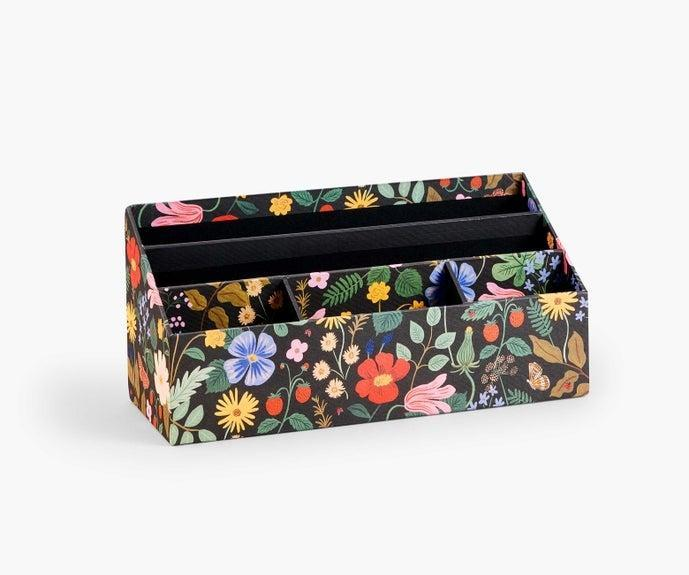 "<h2>Rifle Paper Co. Desk Organizer</h2><br>Rifle Paper Co. always delivers products that are both functional and stylish. This desk organizer is part of the retailer's <a href=""https://riflepaperco.com/catalogsearch/result/?q=strawberry+fields"" rel=""nofollow noopener"" target=""_blank"" data-ylk=""slk:Strawberry Fields"" class=""link rapid-noclick-resp"">Strawberry Fields</a> collection that was made to brighten up your workweek. <br><br>Shop <strong><em><a href=""http://riflepaperco.com"" rel=""nofollow noopener"" target=""_blank"" data-ylk=""slk:Rifle Paper Co."" class=""link rapid-noclick-resp"">Rifle Paper Co.</a></em></strong><br><br><strong>Rifle Paper Co.</strong> Desk Organizer, $, available at <a href=""https://go.skimresources.com/?id=30283X879131&url=https%3A%2F%2Friflepaperco.com%2Fstrawberry-fields-desk-organizer"" rel=""nofollow noopener"" target=""_blank"" data-ylk=""slk:Rifle Paper Co"" class=""link rapid-noclick-resp"">Rifle Paper Co</a>"