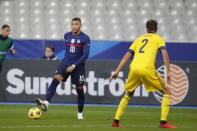 France's Kylian Mbappe controls the ball as Sweden's Mikael Lustig defends during the UEFA Nations League soccer match between France and Sweden at the Stade de France stadium in Saint-Denis, northern Paris, Tuesday, Nov. 17, 2020. (AP Photo/Francois Mori)