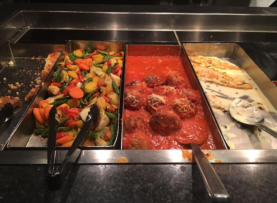 meatball and vegetable serving stations at corner market buffet in las vegas