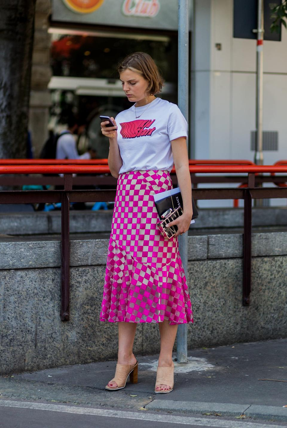 <p>Dress down a skirt with easy mules and a T-shirt for casual vibes that speak to summer. </p>