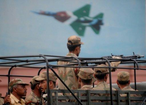 This file photo shows Pakistani soldiers arriving for a military operation against militants at Pakistan's naval air base following an attack by militants in Karachi on May 23, 2011. The 2011 attack claimed by the Taliban took 17 hours to quell, piling embarrassment on the armed forces just three weeks after US troops killed Osama bin Laden in Pakistan
