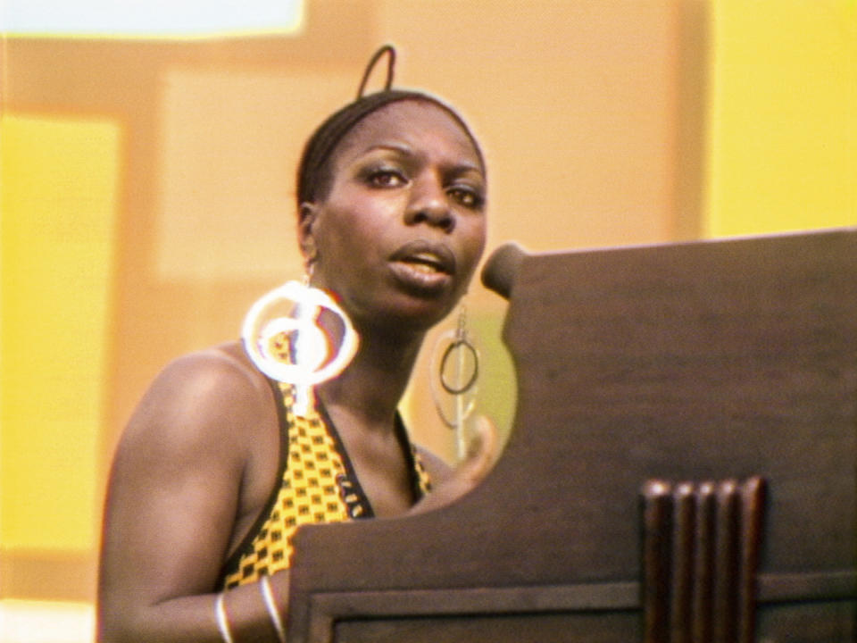 """This image released by Searchlight Pictures shows Nina Simone performing at the Harlem Cultural Festival in 1969, featured in the documentary """"Summer of Soul."""" (Searchlight Pictures via AP)"""