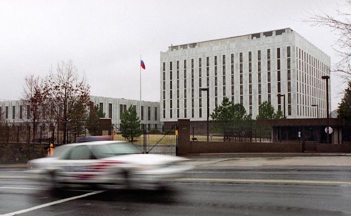 A police car drives past the Russian Embassy in Washington DC (AFP Photo/Shawn Thew)