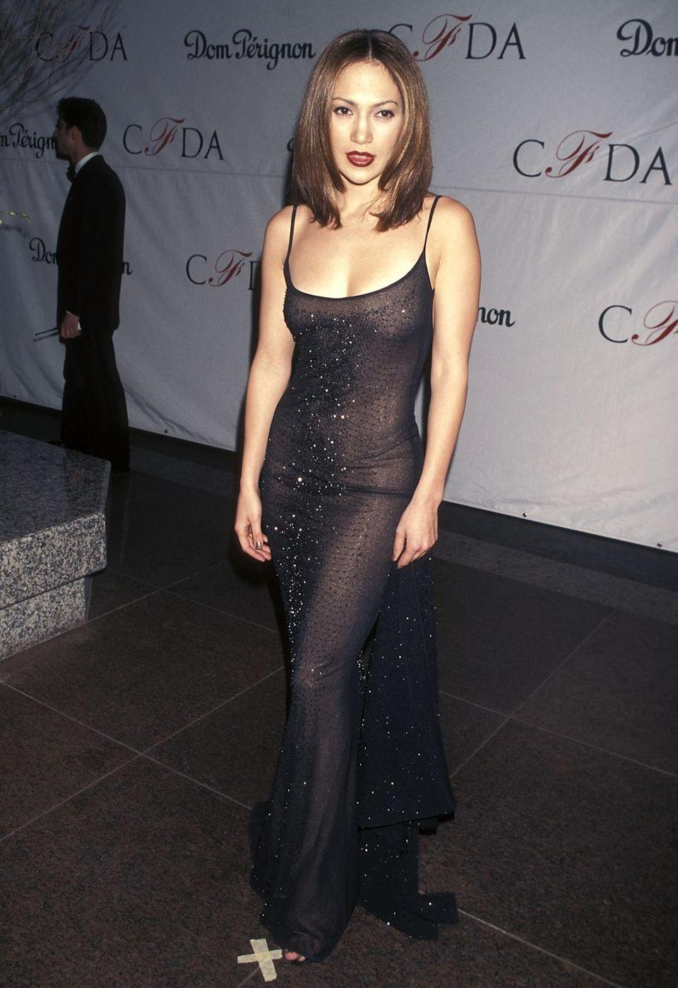 <p>A nineties dream in a spaghetti-strap sheer black gown paired with a shoulder-length blow-dried bob and dark red lip.</p>