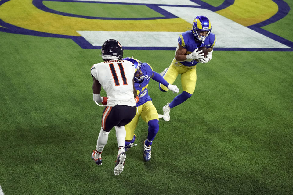 Los Angeles Rams safety Taylor Rapp, right, intercepts a tipped pass intended for Chicago Bears wide receiver Darnell Mooney (11) during the second half of an NFL football game Monday, Oct. 26, 2020, in Inglewood, Calif. (AP Photo/Ashley Landis )