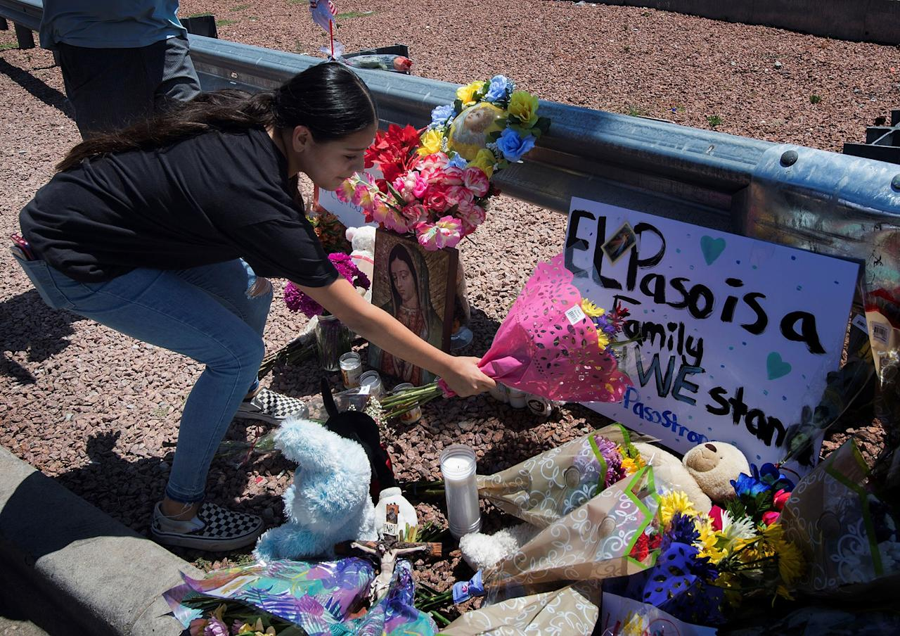 Flowers were placed near a makeshift memorial outside the Cielo Vista Mall WalMart in El Paso.
