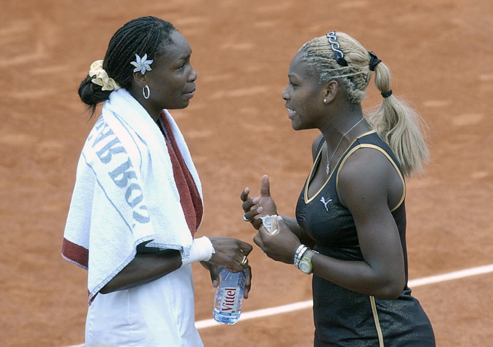 FILE - In this June 8, 2002, file photo, Serena Williams, right, talks with her sister Venus after Serena won the women's final of the French Open tennis tournament at Roland Garros stadium in Paris. Serena Williams defeated her sister Venus 7-5, 6-3. Williams has only won two clay-court matches over the past two years and says her lack of competition on the surface makes her uncomfortable ahead of the French Open. The tournament begins Sunday in Paris. (AP Photo/Christophe Ena, File)