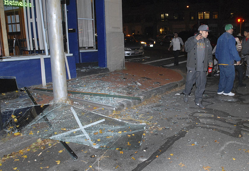 Glass and debris litter a street after a nearby building was leveled by an explosion Friday, Nov. 23, 2012 in downtown Springfield, Mass. (AP Photo/Springfield Republican, David Molnar) MANDATORY CREDIT