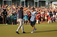 Phil Mickelson celebrates his US PGA Championship victory with brother and caddie Tim Mickelson