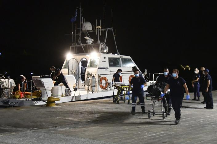 A coast guard vessel arrives with two bodies at Pythagorio port, on the eastern Aegean island of Samos, Greece, late Monday, Sept. 13, 2021. Authorities in Greece Tuesday opened an investigation into the crash of a private plane from Israel that killed a prosecution witness in the corruption trial of former Israeli prime minister Benjamin Netanyahu. Haim Geron, a former senior official at Israel's ministry of communications, and his wife Esther were killed in the crash late Monday off the island of Samos. (AP Photo/Michael Svarnias)