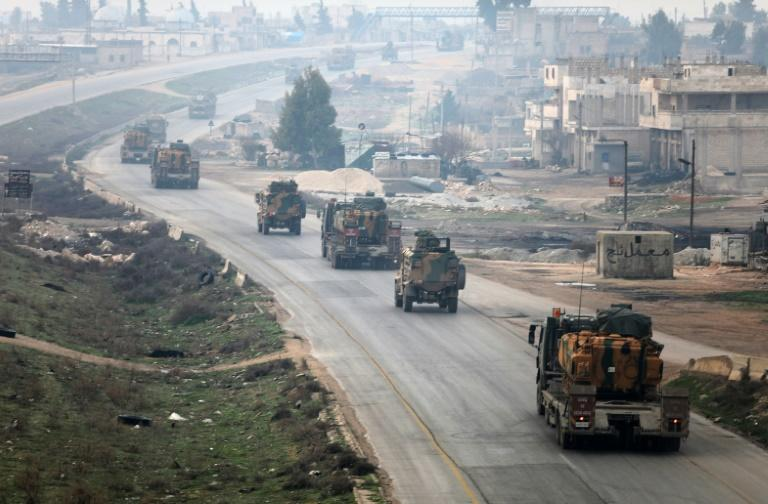 A Turkish military convoy driving through Syria's northwestern Idlib province