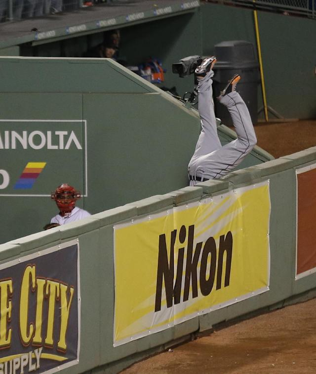 Detroit Tigers' Torii Hunter leaps and misses a catch as Boston Red Sox's David Ortiz hits a grand slam home run in the eighth inning during Game 2 of the American League baseball championship series Sunday, Oct. 13, 2013, in Boston. (AP Photo/Charlie Riedel)