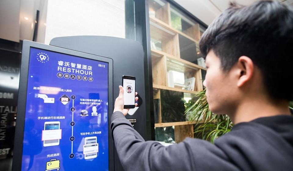 A passenger uses the mobile payment app Alipay to verify himself as he checks in at a hotel in Hangzhou, Zhejiang Province. Photo: Getty Images