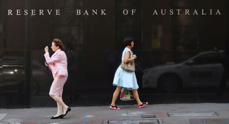 FILE PHOTO: Two women walk next to the Reserve Bank of Australia headquarters in central Sydney