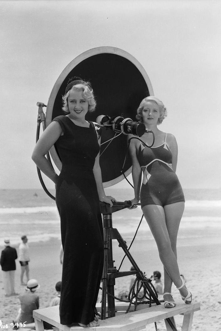 <p>Bette Davis (right) smiles next to her costar, Joan Blondell, during a beach shoot for their movie <em>Three on a Match</em> in 1932.  </p>