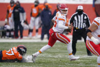 Kansas City Chiefs quarterback Patrick Mahomes gets away from Denver Broncos defensive end DeMarcus Walker, left, during the first half of an NFL football game Sunday, Oct. 25, 2020, in Denver. (AP Photo/David Zalubowski)