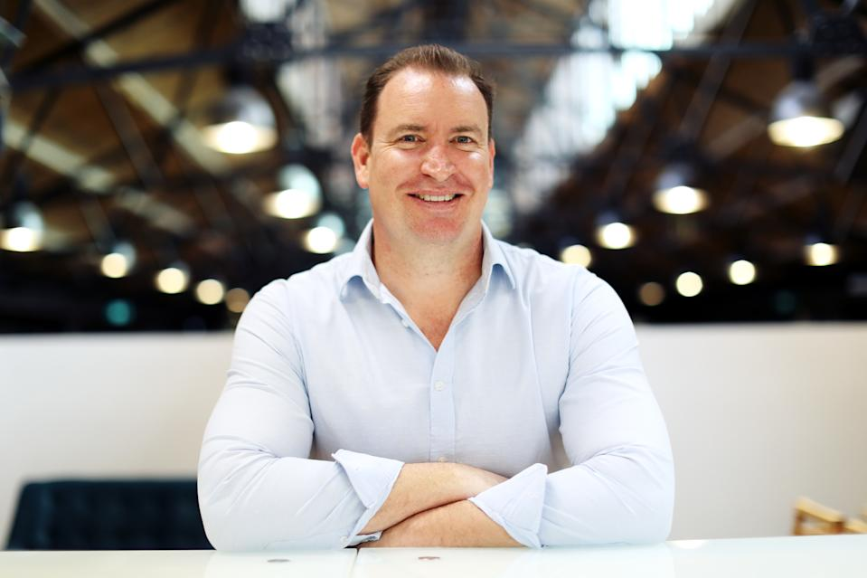 Founder and chief of superannuation platform Roll-It Super, Mark MacLeod, with arms folded.