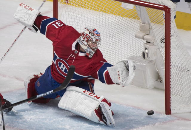 Montreal Canadiens goaltender Carey Price is scored on by St. Louis Blues' Brayden Schenn during the third period of an NHL hockey match, in Montreal, Wednesday, Oct. 17, 2018. (Graham Hughes/The Canadian Press via AP)