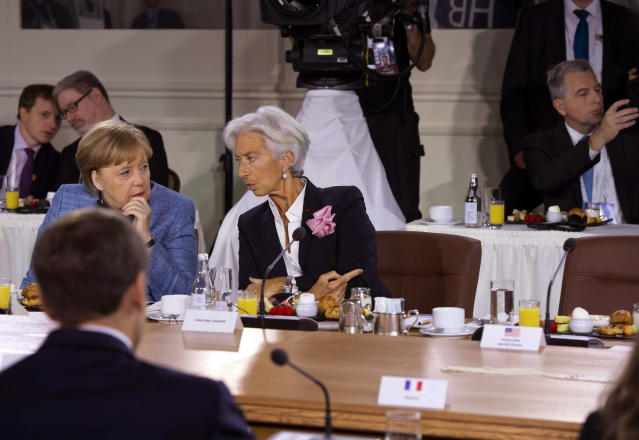 <p>German Chancellor Angela Merkel and IMF Managing Director Christine Lagarde wait for the arrival of President Donald Trump to the Gender Equality Advisory Council breakfast during the G-7 summit, Saturday, June 9, 2018, in Charlevoix, Canada. (Photo: Justin Tang/The Canadian Press via AP) </p>