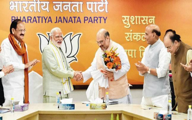 BJP's top leadership comes together to brainstorm over CM picks for UP and Uttarakhand