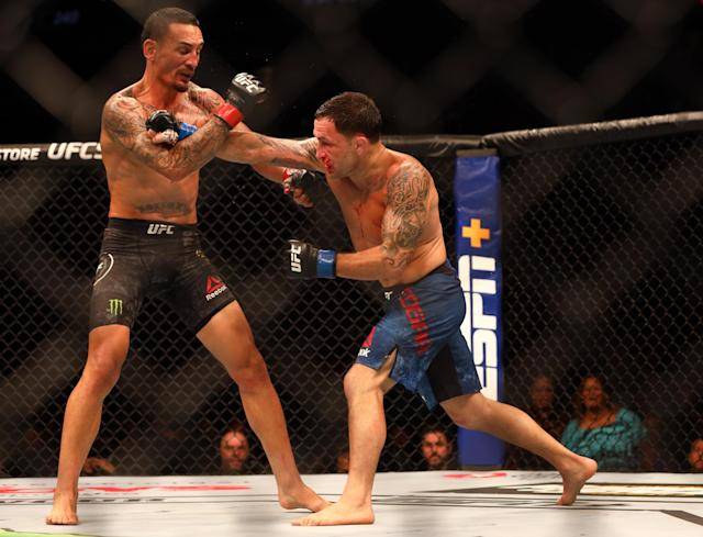Max Holloway (R) and Frankie Edgar during UFC 240 at Rogers Place. (Sergei Belski/USA Today Sports)