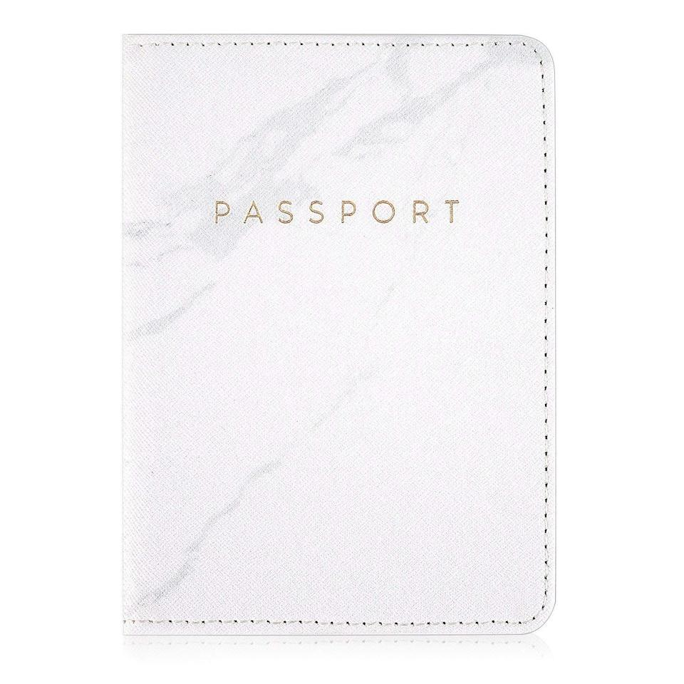 """<h3><a href=""""https://amzn.to/2wvANrn"""" rel=""""nofollow noopener"""" target=""""_blank"""" data-ylk=""""slk:Leather Passport Holder"""" class=""""link rapid-noclick-resp"""">Leather Passport Holder</a></h3><br><strong>Amanda</strong><br><br><strong>How She Discovered It:</strong> """"I was looking for a Christmas gift that I could give to all of my aunts.""""<br><br><strong>Why It's A Hidden Gem:</strong> """"It looks and feels great, and the marbled motif is very pretty. Because all of my family will be traveling for my wedding next year, this was a cute and fun way to thank the girls in our group.""""<br><br><strong>Leminimo</strong> Leather Marble Passport Holder, $, available at <a href=""""https://www.amazon.com/gp/product/B079L6F347"""" rel=""""nofollow noopener"""" target=""""_blank"""" data-ylk=""""slk:Amazon"""" class=""""link rapid-noclick-resp"""">Amazon</a>"""