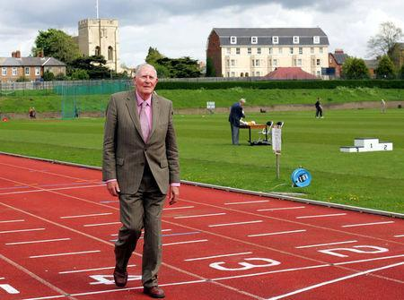 FILE PHOTO: Sir Roger Bannister walks over the same finish line at the Iffley Road running track in Oxford that he crossed fifty years ago when he was the first man to run the sub four minute mile, May 6, 2004. REUTERS/David Bebber/File Photo